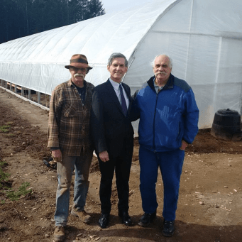 Glen with MLA Simon Gibson and Emma's Acres staff Ray King Sr.
